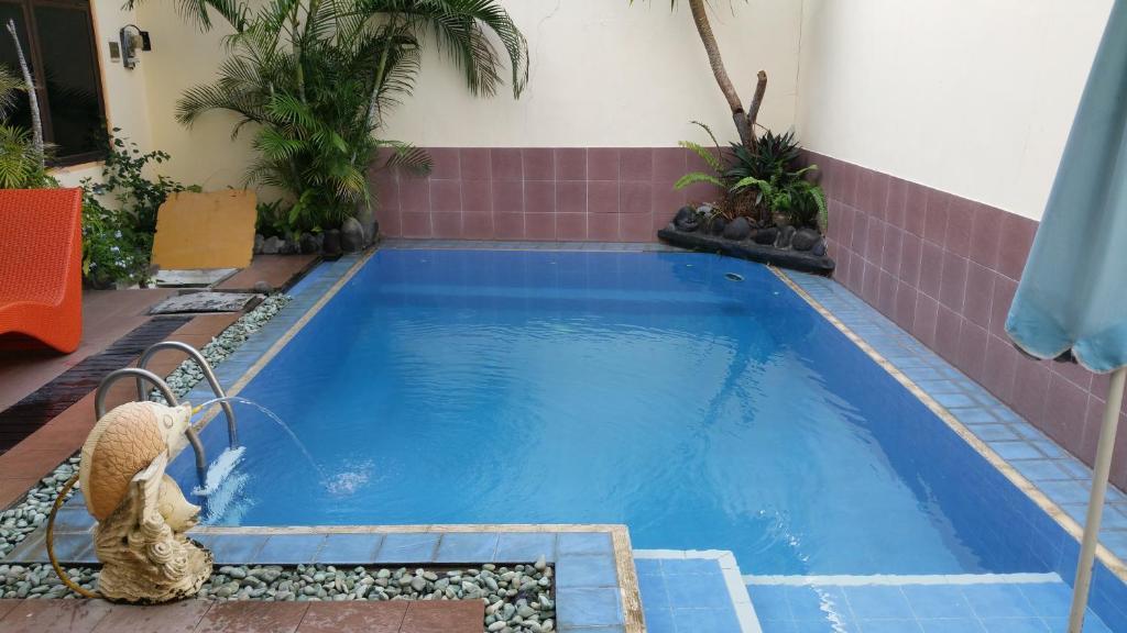 Bazén v ubytování Ayu Taman Sari nebo v jeho okolí