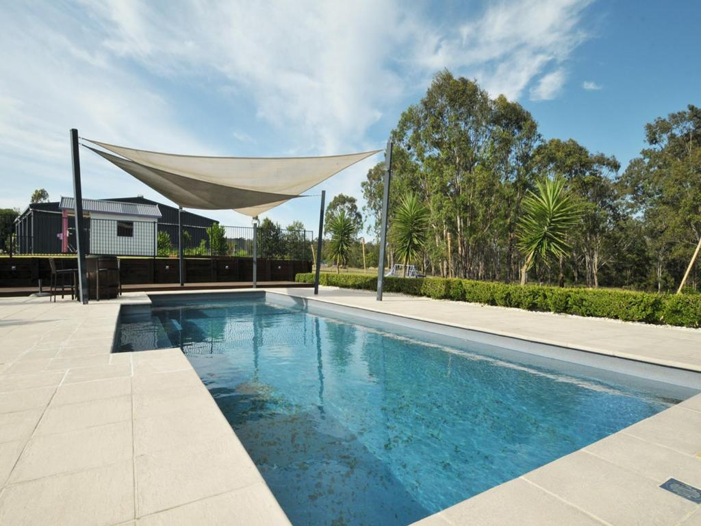 The swimming pool at or near The Ponderosa on Merewether, more like a Resort than a Homestead
