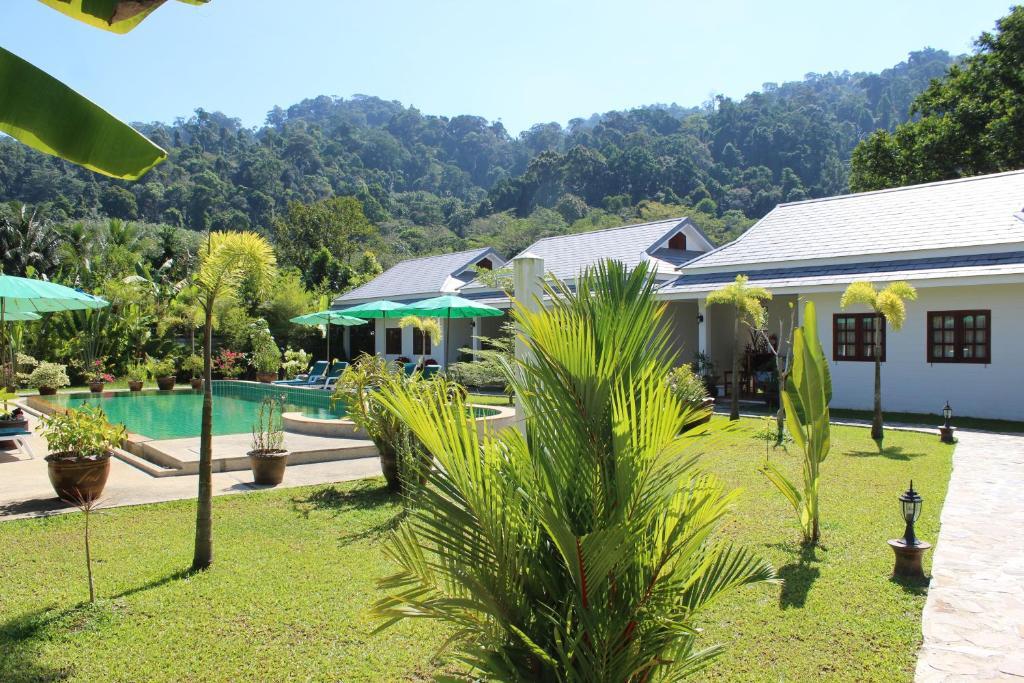A garden outside Villa Colina Khao Lak - Adults Only