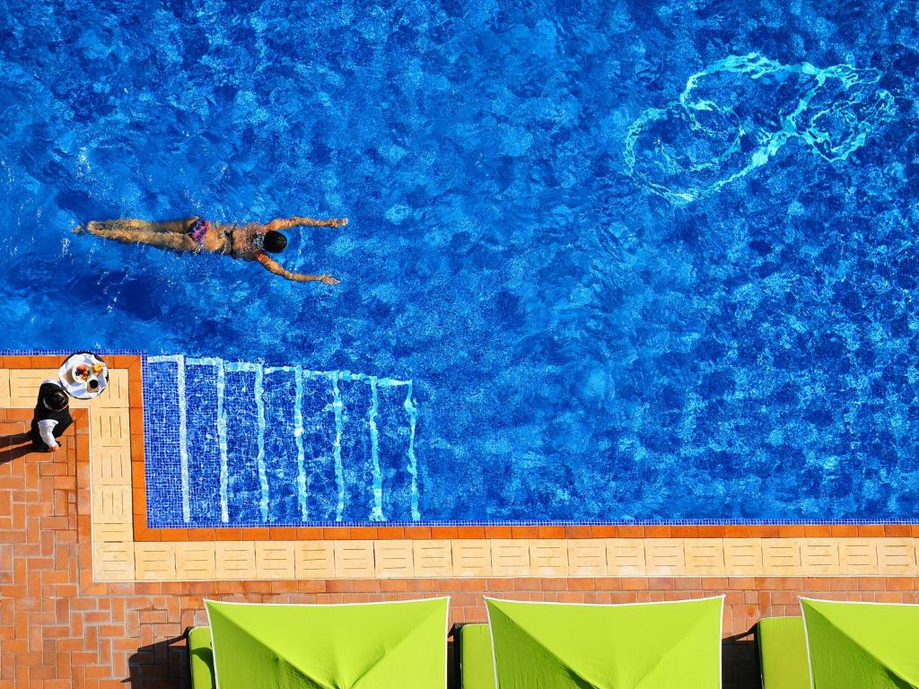 The swimming pool at or near Fraser Suites Seef Bahrain