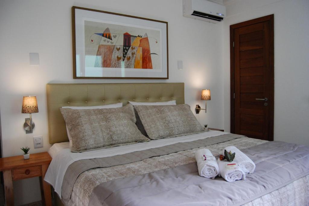 A bed or beds in a room at Pousada Bahia Pelô