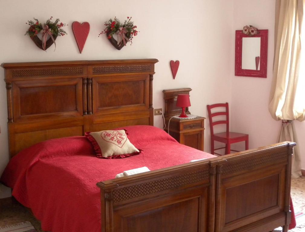 A bed or beds in a room at B&B The Lions