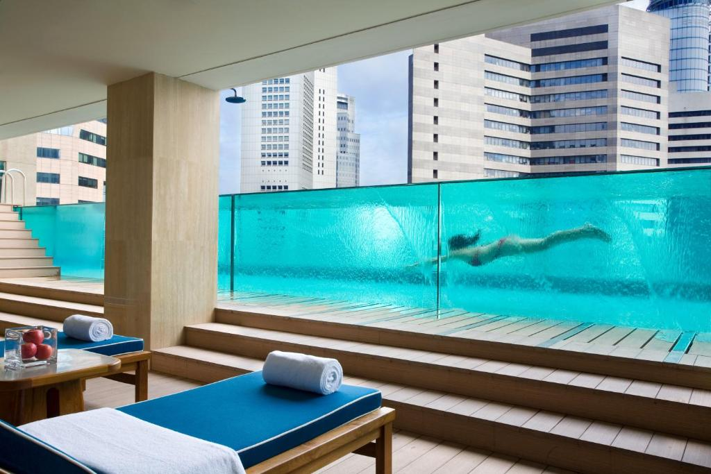The swimming pool at or near Ascott Raffles Place Singapore (SG Clean, Staycation Approved)