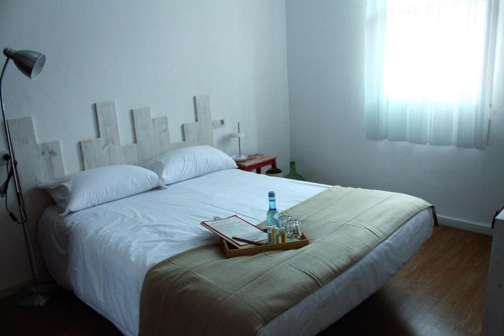A bed or beds in a room at MON ComeySueña Guesthouse