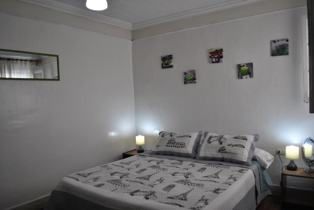 A bed or beds in a room at Hostel La Vitrola