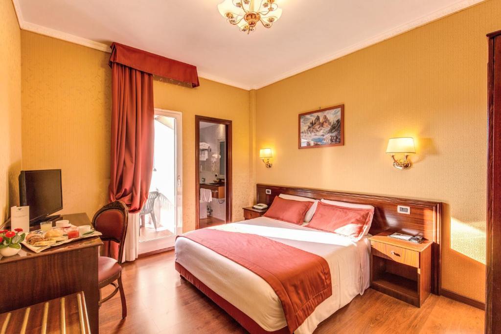 Hotel Impero tesisinde bir odada yatak veya yataklar