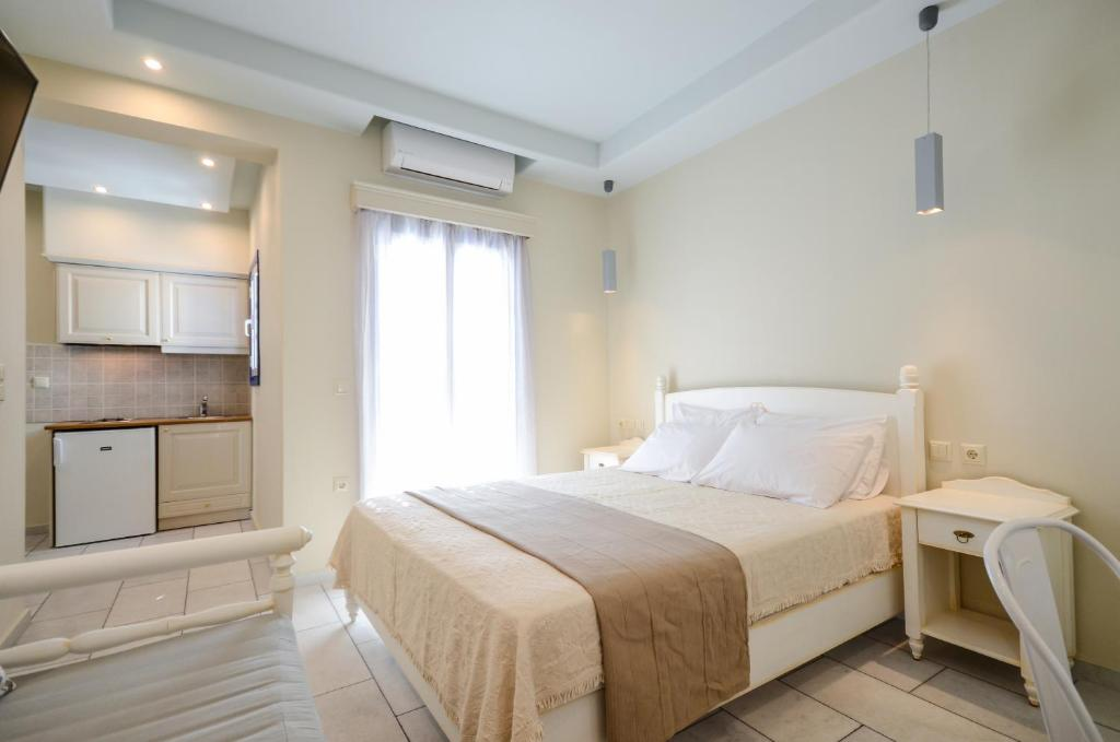A bed or beds in a room at Vasilikos Studios
