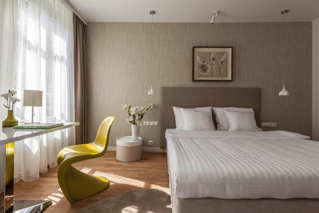 A bed or beds in a room at Casati Budapest Hotel Superior