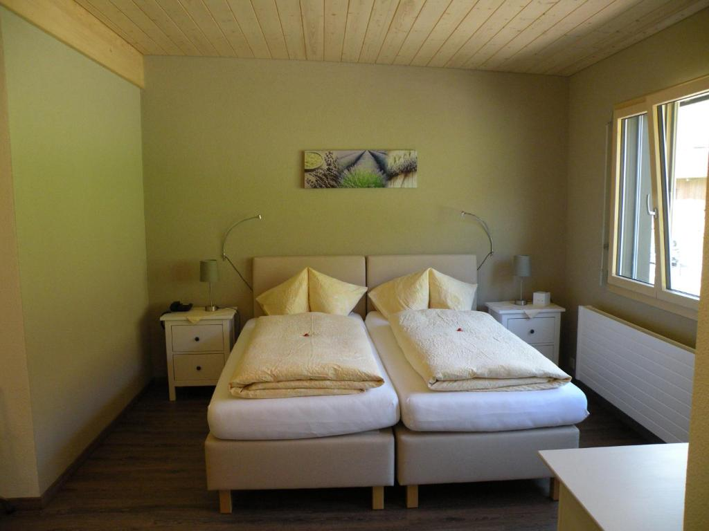 A bed or beds in a room at Hotel Restaurant Rustica