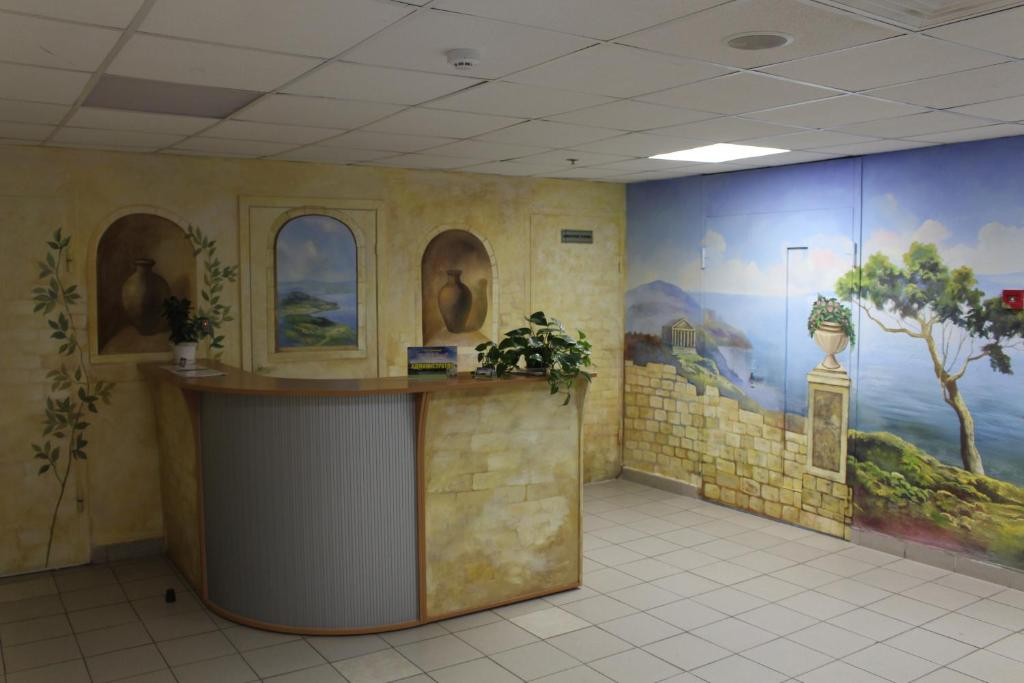 The lobby or reception area at Hotel Sportivnaya