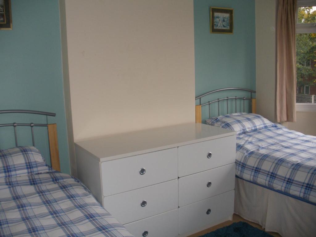 Voodi või voodid majutusasutuse Gatley Homestay toas