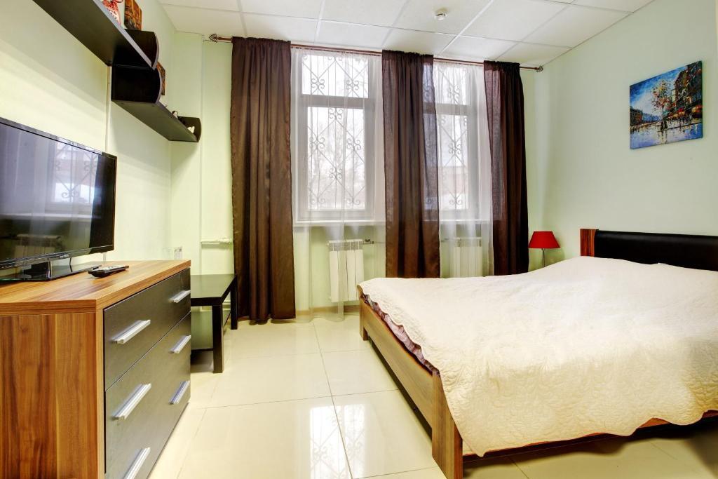 Кровать или кровати в номере Мини гостиница Брусника
