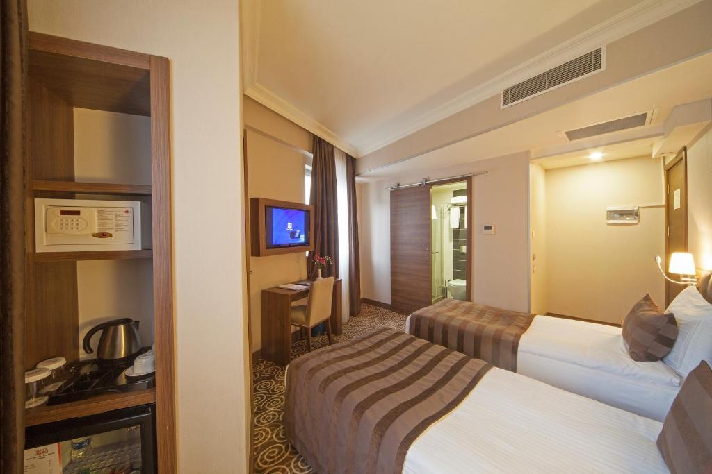 Кровать или кровати в номере Delta Hotel Istanbul
