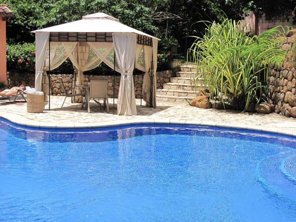 The swimming pool at or near Los Almendros de San Lorenzo