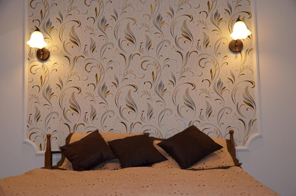 A bed or beds in a room at Apartment Vinnichenko 1