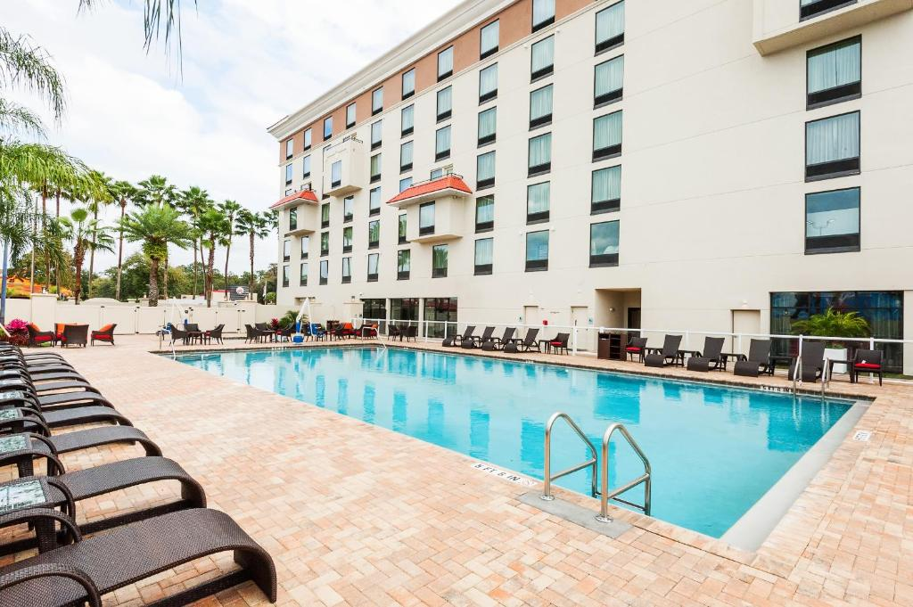 The swimming pool at or near Delta Hotels by Marriott Orlando Lake Buena Vista