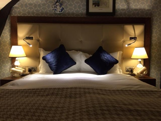 A bed or beds in a room at The Crown Wetherspoon