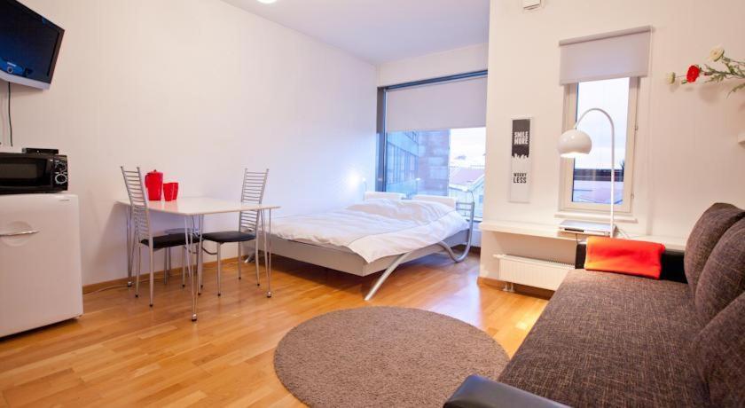 Voodi või voodid majutusasutuse Volta Apartments Lootsi toas