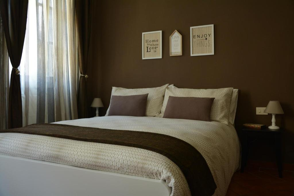 A bed or beds in a room at Stilnovo House