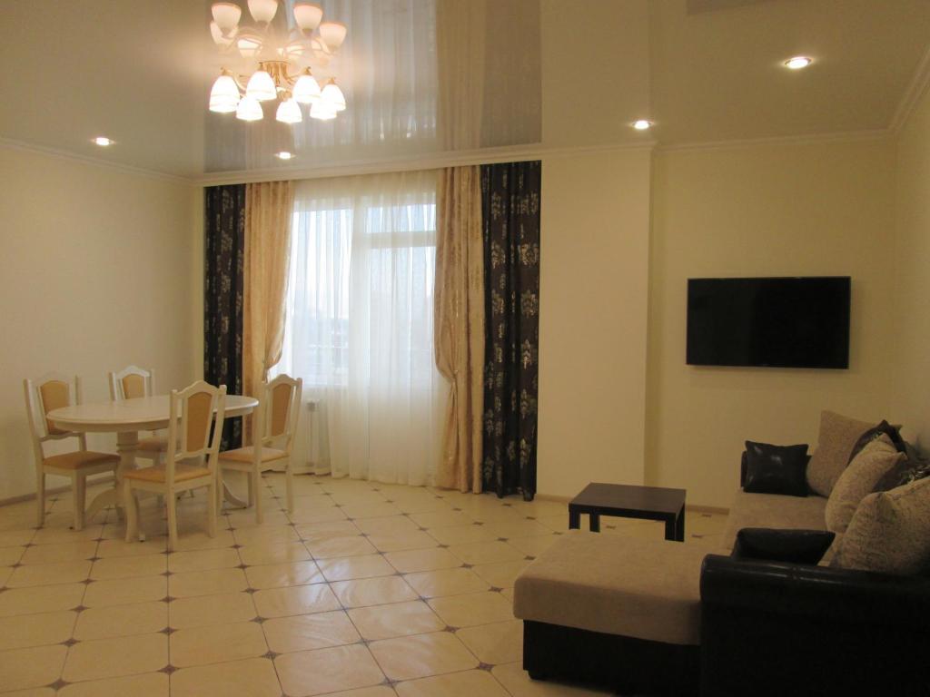 Гостиная зона в Апартаменты на ул. Просвещения 84