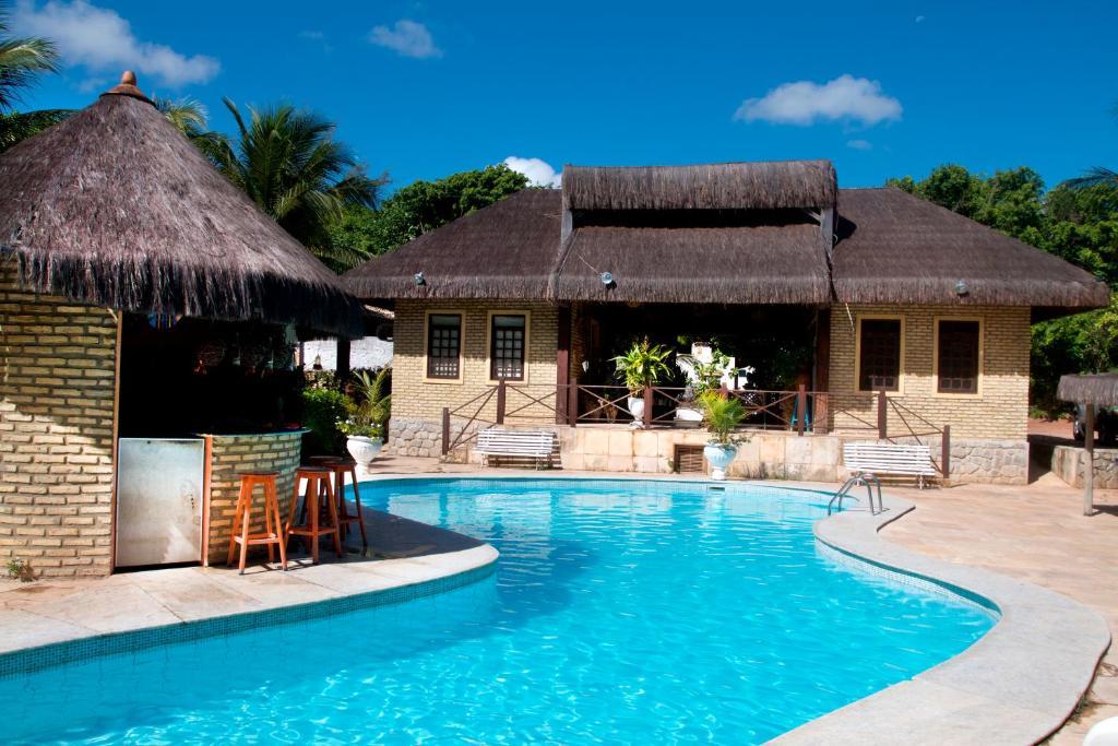 A piscina localizada em Pousada Império do Sol ou nos arredores