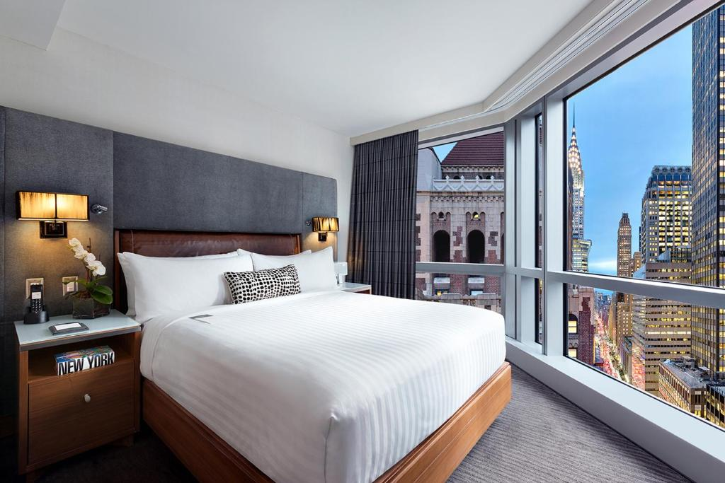 A bed or beds in a room at Hotel 48LEX New York