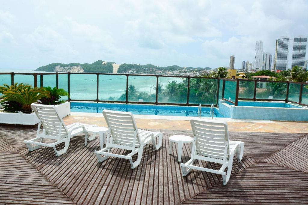 The swimming pool at or near Araçá Praia Flat