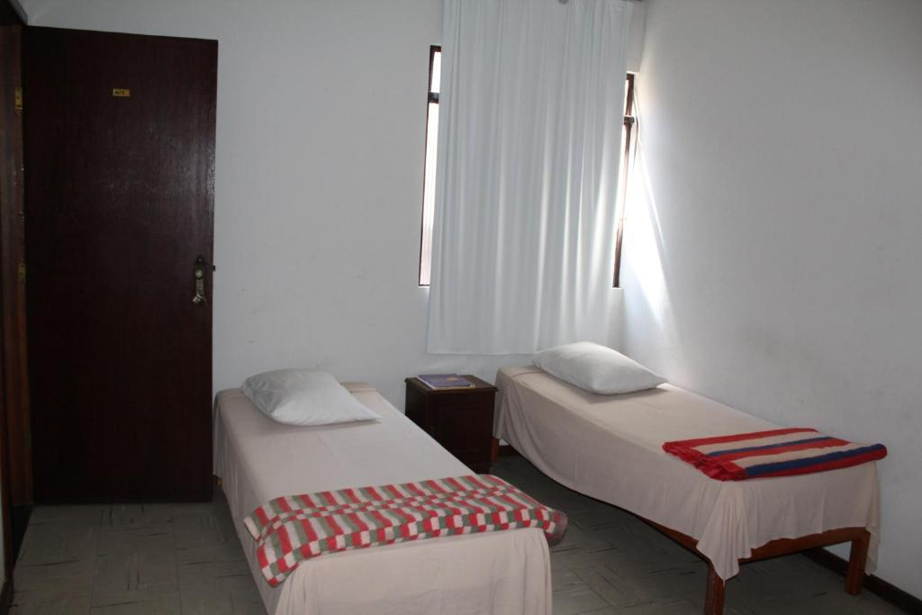 A bed or beds in a room at Hotel Aquarius