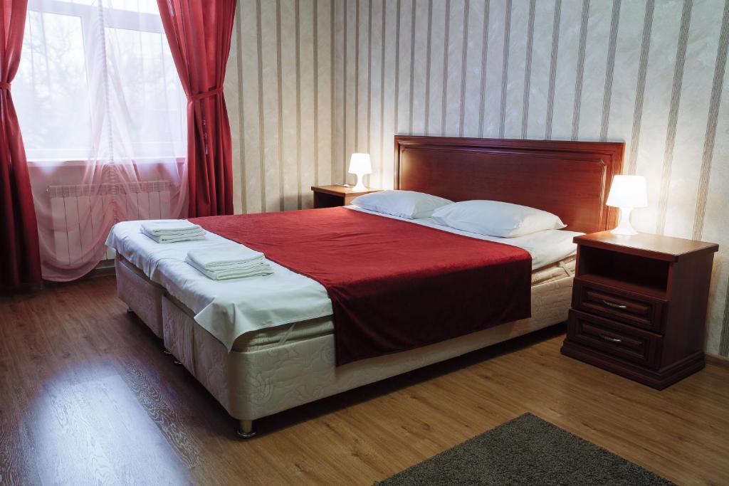 Кровать или кровати в номере EdVit