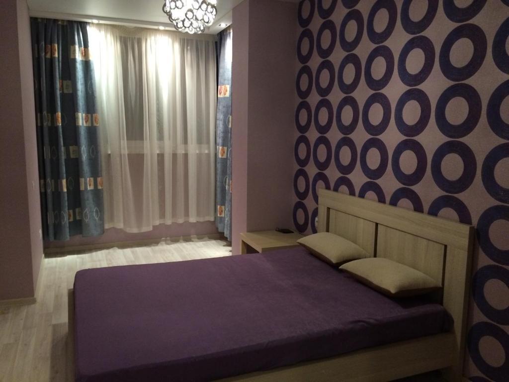 Кровать или кровати в номере Apartment On Lenina 156