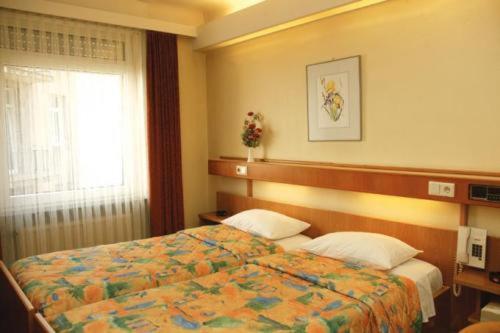 Ein Bett oder Betten in einem Zimmer der Unterkunft Hotel Zurich