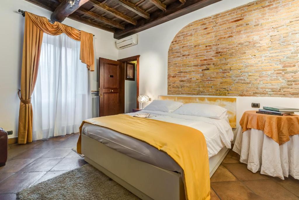 Un ou plusieurs lits dans un hébergement de l'établissement Luxury Trastevere