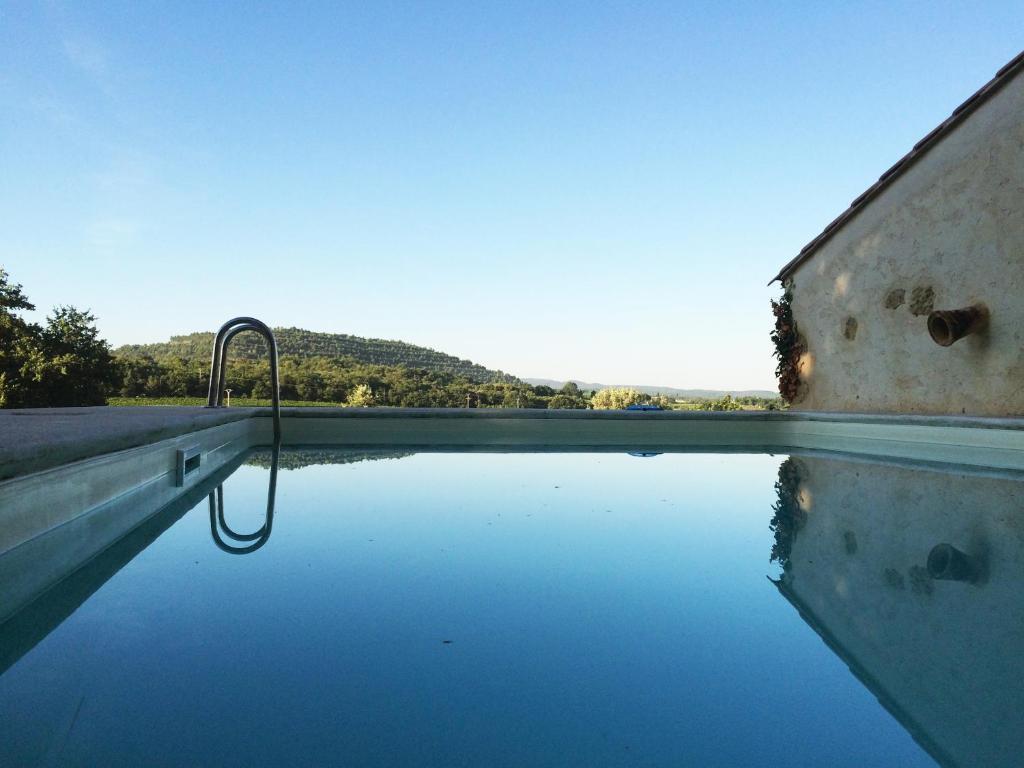 The swimming pool at or near Le Mas de Plein Pagnier