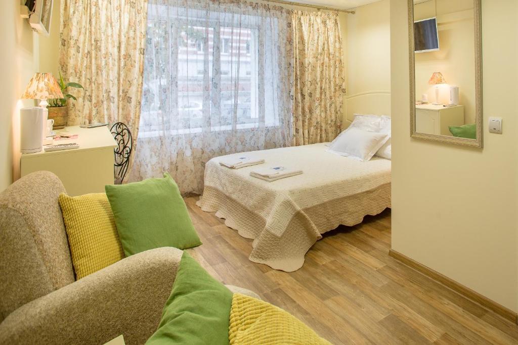 Кровать или кровати в номере Мини-Отель Albergo