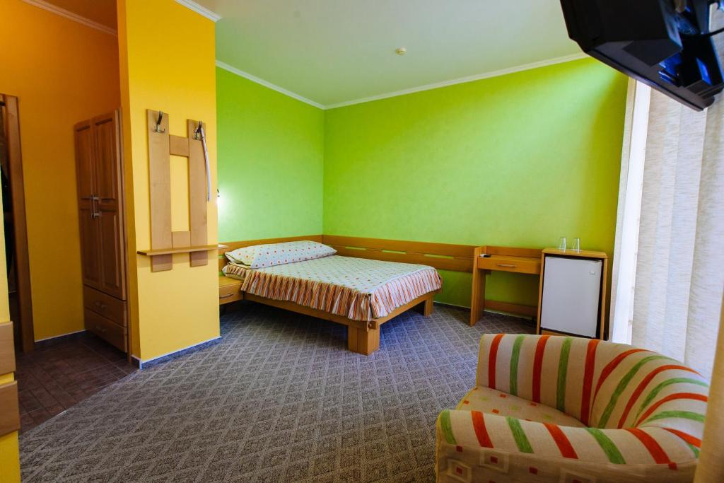 A bed or beds in a room at Zolotoye Runo