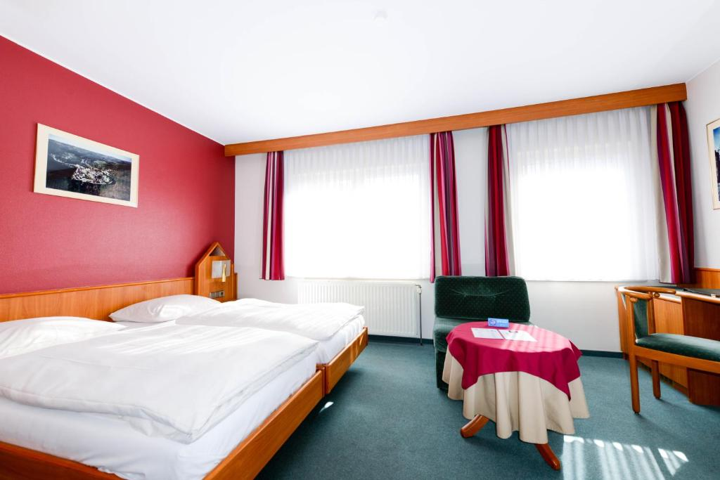 Ein Bett oder Betten in einem Zimmer der Unterkunft Christophe Colomb