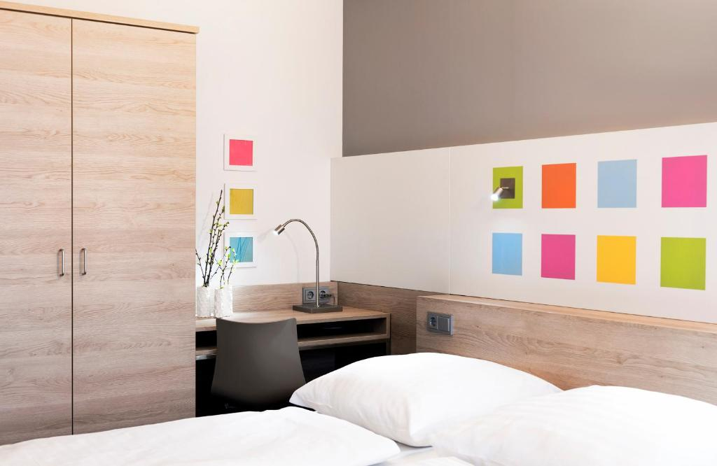 A bed or beds in a room at Business & Budget Hotel Tessin