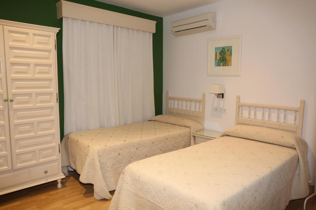 Ein Bett oder Betten in einem Zimmer der Unterkunft Hostal La Janda