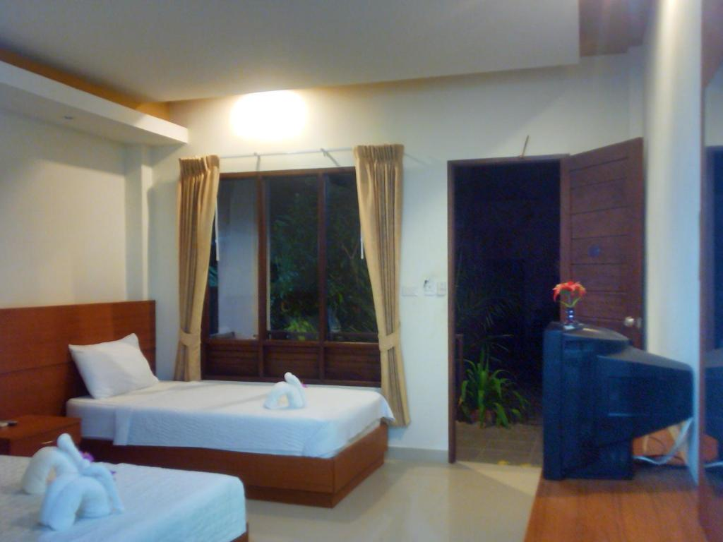 A bed or beds in a room at Modern Resort
