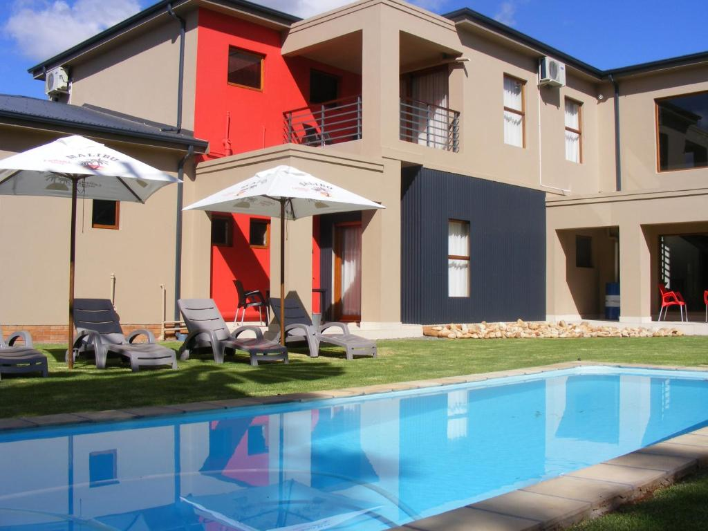 The swimming pool at or close to Karoo Sun Boutique Guest House