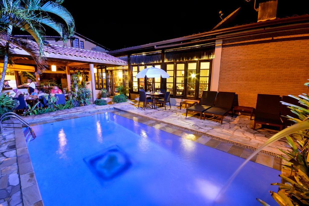 The swimming pool at or near Estalagem Casa Grande Pousada