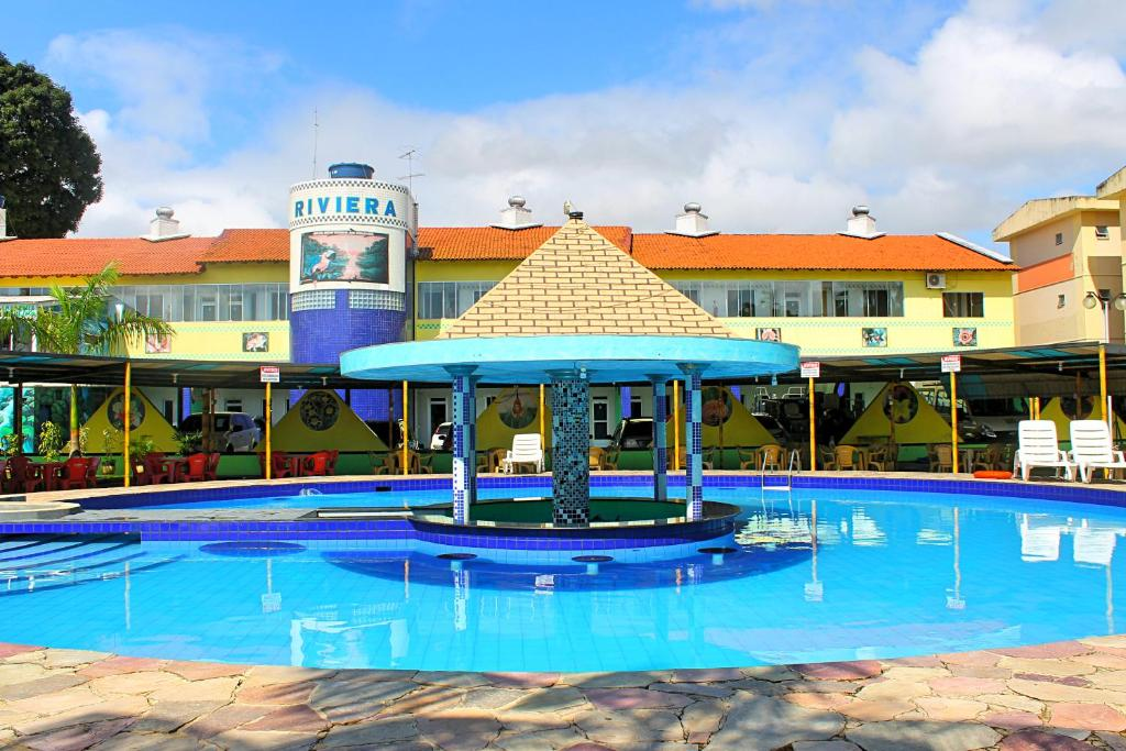 The swimming pool at or near Hotel Riviera D Amazonia Belem Ananindeua