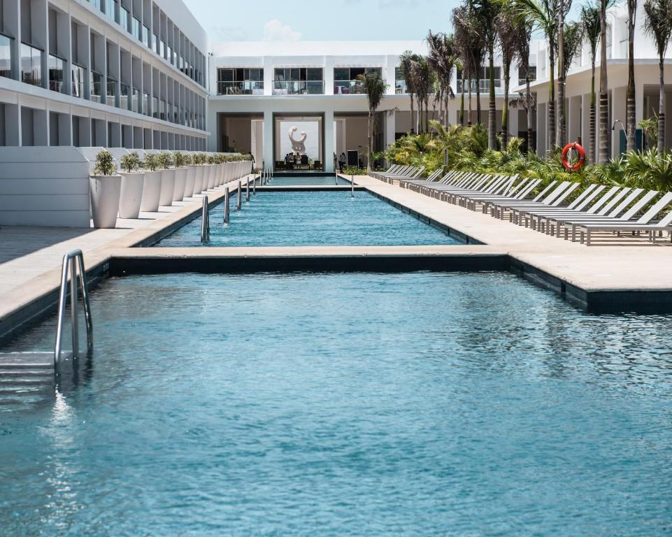 The swimming pool at or near Platinum Yucatan Princess All Inclusive Suites & Spa Resort - Adults Only