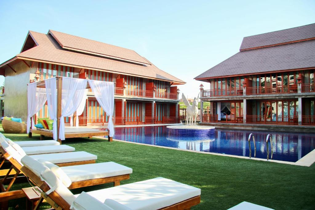 The swimming pool at or near The Chaya Resort and Spa