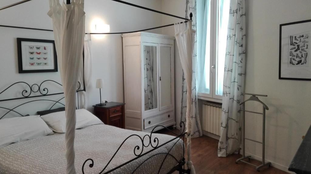 A bed or beds in a room at Appartamento Zeno