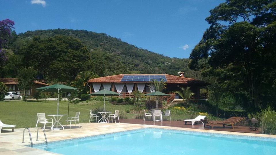 The swimming pool at or close to Pousada Tucano Do Cuiabá