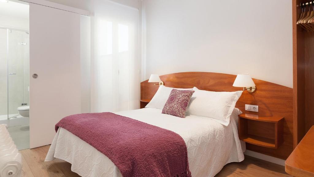 Cama o camas de una habitación en Hostal Oliva