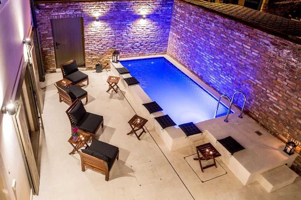 The swimming pool at or near Splendida Palace