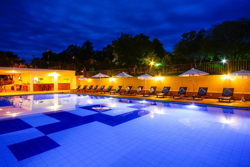 The swimming pool at or near Hotel Fazenda Areia que Canta