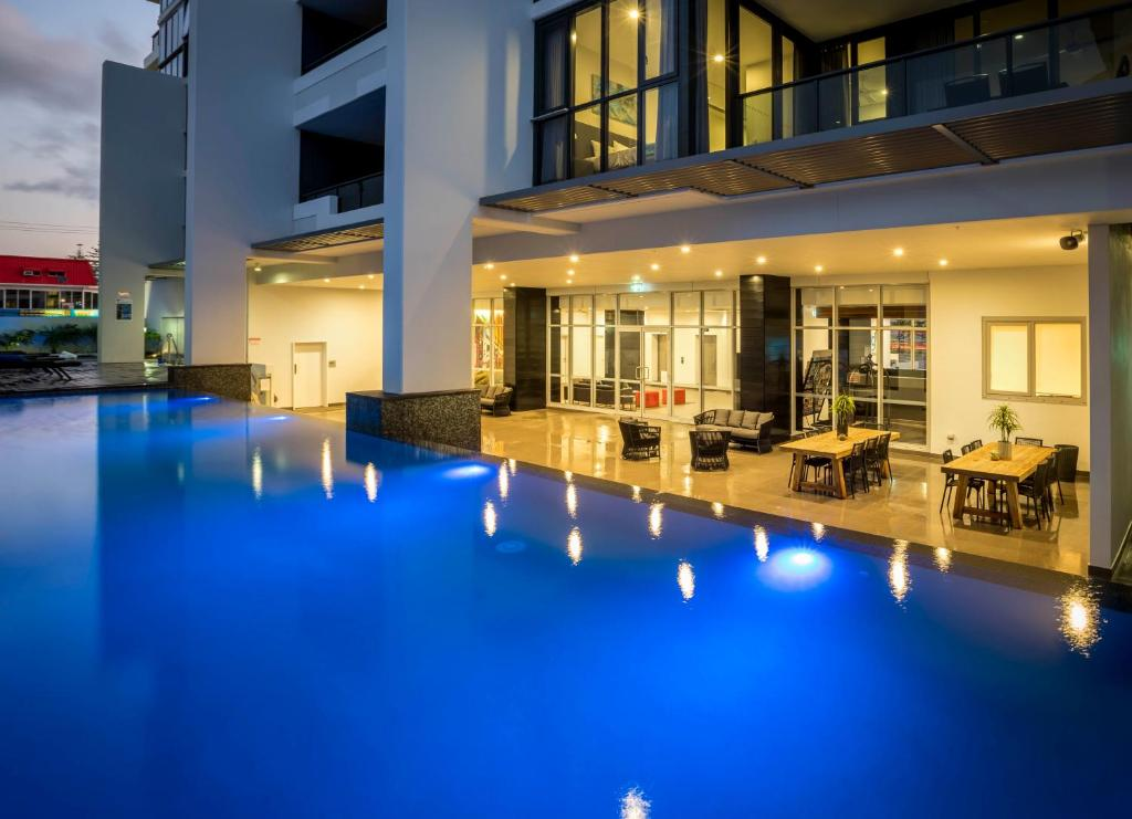 The swimming pool at or near Synergy Broadbeach - Official
